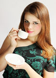 Lady holds cup Royalty Free Stock Image