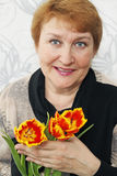Lady holds a tulips Royalty Free Stock Images