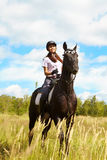 Lady on horse Stock Photo