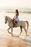 Lady horse ride beach. Happy young lady enjoying horse ride on beach Stock Photos