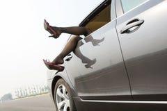Lady i bilen Arkivbild