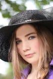 Lady i en hatt Arkivfoto