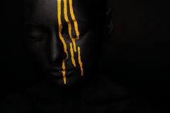 Lady In Black Paint With Yellow Smudges Royalty Free Stock Images