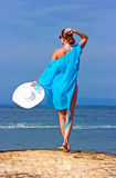 Lady In Blue Shawl On The Beach Stock Image