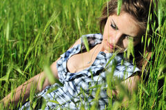 Lady In Grass Stock Photo