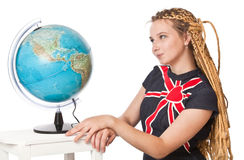 Lady in jean dress with globe. Stock Images