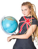 Lady in jean dress with globe. Stock Photos