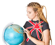 Lady in jean dress with globe. Royalty Free Stock Images