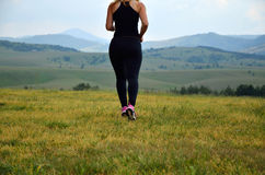 Lady jogging in the mountain Royalty Free Stock Photos