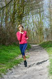 Lady Jogging in a Park Royalty Free Stock Image