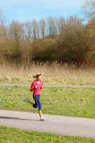 Lady Jogging in a Park Stock Photography
