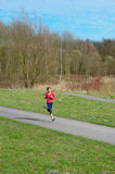 Lady Jogging in a Park Royalty Free Stock Photos