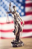 Lady Justice and American flag. Symbol of law and justice with U Royalty Free Stock Images