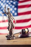 Lady Justice and American flag. Symbol of law and justice with U Stock Images