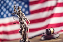 Lady Justice and American flag. Symbol of law and justice with U stock image