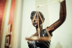 Lady justice. Bronze statue of the blind and impartial Lady Justice holding scales Royalty Free Stock Photography