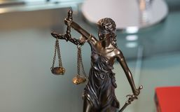 Lady justice in an office of an attorney. Close up of Lady justice on desk of an attorney Stock Image