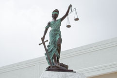 Lady Justice at Palace of Justice in Chetumal. Beautiful bronze statue of Lady Justice blindfolded holding balancing scales in one hand and sword in other in stock image