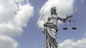 Lady Justice. Statue of Lady Justice in front of moving clouds stock video footage