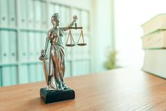 Lady Justice statue in law firm office stock photo