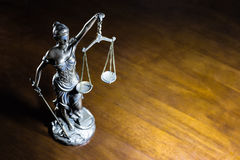 Lady Justice. Statue and legal book (Justice Concept Stock Photography