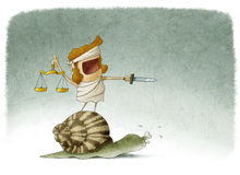 Lady justice on top of a snail Stock Photo