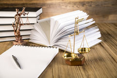 Lady of justice, Wooden & gold gavel and books Royalty Free Stock Photo