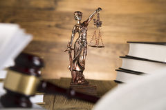 Lady of justice, Wooden & gold gavel and books Royalty Free Stock Photography