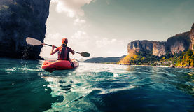 Lady with kayak Stock Image