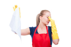 Lady keeping smelly tissue at distance. Lady keeping smelly tissue or rag at distance and pinching her nose because of bad smell royalty free stock image