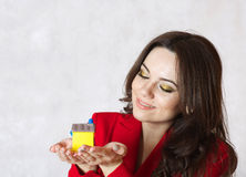 A lady keeps a small rubber house Stock Photography