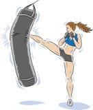 Kickboxergirl. Lady kickboxer killing the bag Royalty Free Stock Photo