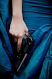 Lady killer. Close up photo of female assassin wearing blue gown Royalty Free Stock Image