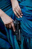 Lady killer. Close up photo of female assassin wearing blue gown Royalty Free Stock Photo