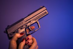 Lady female killer with gun royalty free stock photos