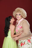 Lady Kisses A Drag Queen Royalty Free Stock Images
