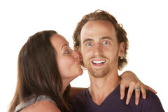 Lady Kisses Excited Man Royalty Free Stock Photography