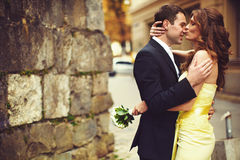 Lady kisses man's nose somewhere on the street. Aa royalty free stock images