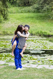 Lady Kissing her Lover in Front Pond Stock Images
