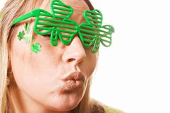 Kiss Me Irish St. Patrick`s Day. A lady kissing on St. Patrick`s Day isolated on white Royalty Free Stock Image