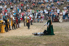 Lady knight won a duel stock photo