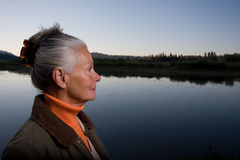 Lady at the lake Stock Photography