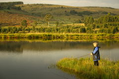 Lady lake fishing Royalty Free Stock Photo
