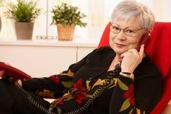lady landline phone senior using Стоковые Изображения