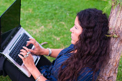 Lady with laptop. Lady woman using laptop outdoors royalty free stock photos