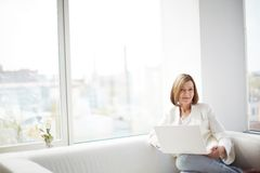 Lady with laptop. Copy-spaced portrait of a lovely business lady with a laptop Stock Images