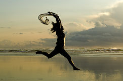 Lady leaps at sunset. Stock Image