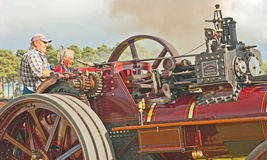 Lady learning to drive a traction engine Royalty Free Stock Images
