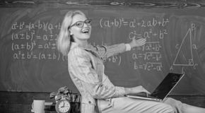 Lady lecturer know how stay in touch modern generation. Teacher of modern generation. Studying in non formal environment. Benefits. Woman teacher hold laptop royalty free stock photos
