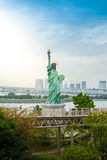 Lady liberty juxtaposed against Rainbow Bridge Royalty Free Stock Photos